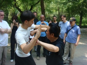 Gao demonstrates on Thad Wong